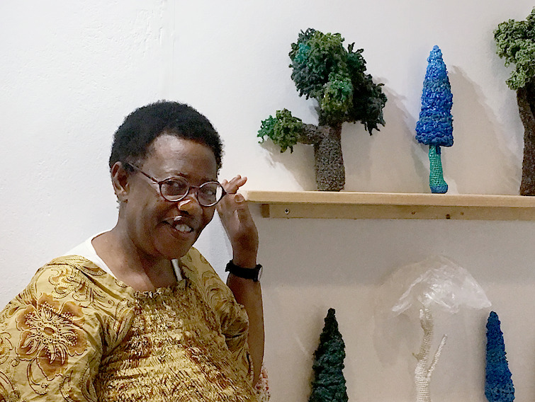 Crochet artist Click with the tree she contributed (top left) during the Treelines Greece opening</cite>